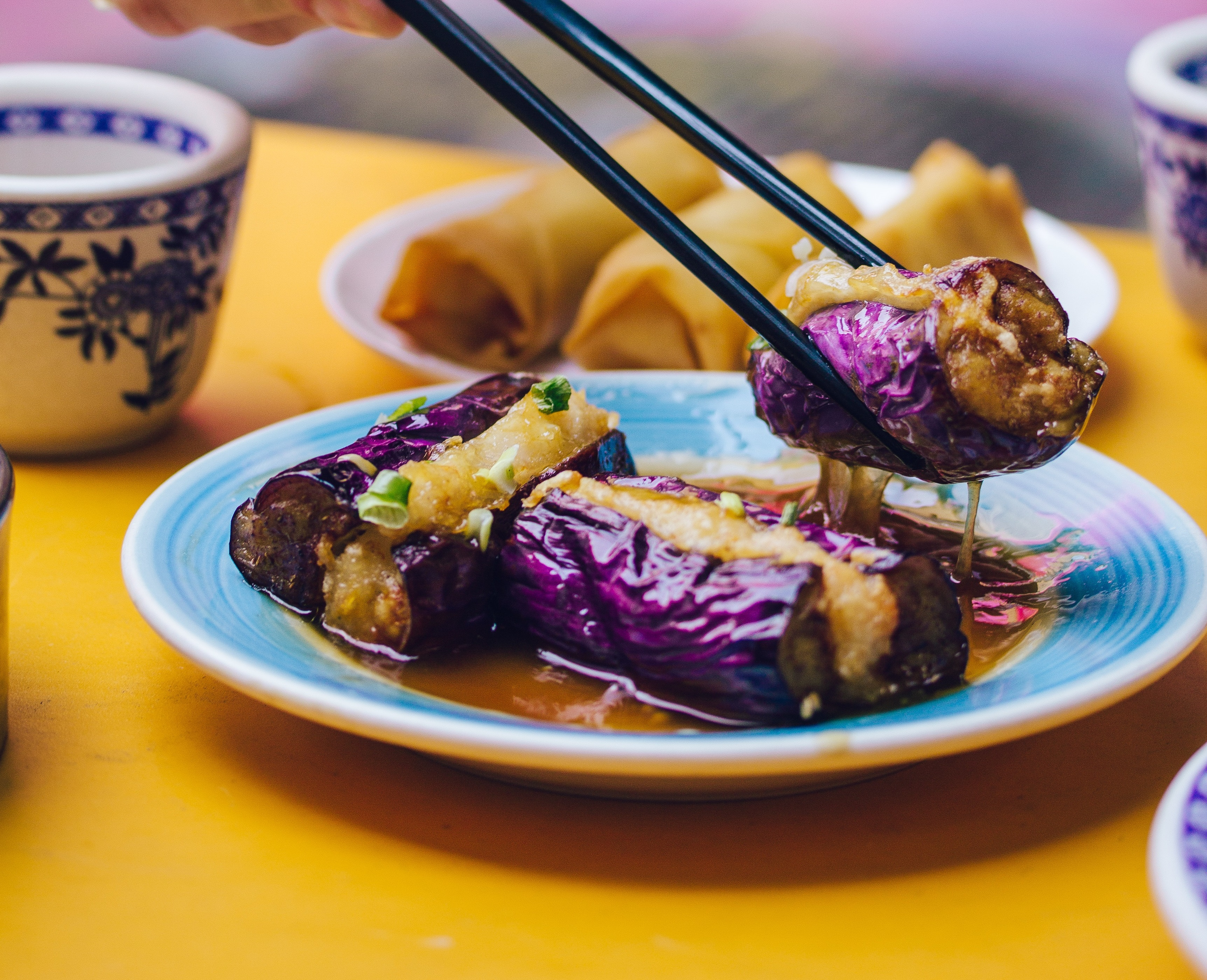 Eggplant held up with chopsticks
