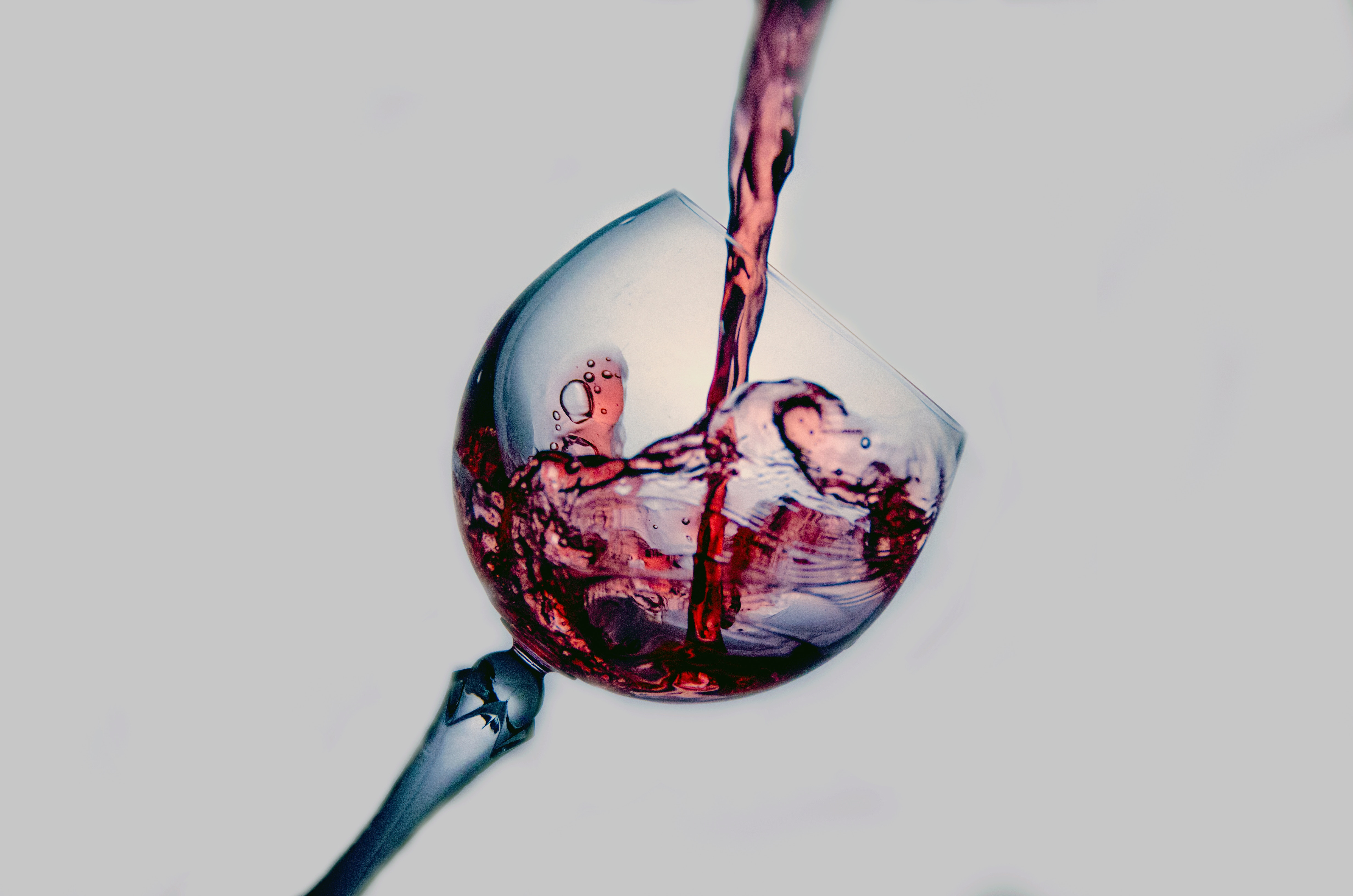 Wine pouring into clear glass